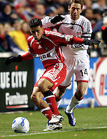 Chicago Fire midfielder Ivan Guerrero (23) shield New England midfielder Steve Ralston (14) from the ball.  The Chicago Fire defeated the New England Revolution 1-0 at Toyota Park in Bridgeview, IL on April 7, 2007.