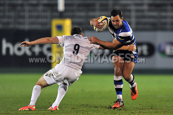 Micky Young looks to get past Ben Spencer. Aviva A-League match, between Bath United and Saracens Storm on September 29, 2014 at the Recreation Ground in Bath, England. Photo by: Patrick Khachfe / Onside Images