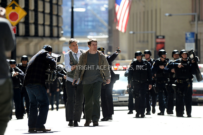 WWW.ACEPIXS.COM<br /> April 11, 2015 New York City<br /> <br /> George Clooney  and Jack O'Connell on the film set of 'Money Monster' in the Financial District of Manhattan on April 11, 2015 in New York City. <br /> <br /> By Line: Kristin Callahan/ACE Pictures<br /> ACE Pictures, Inc.<br /> tel: 646 769 0430<br /> Email: info@acepixs.com<br /> www.acepixs.com