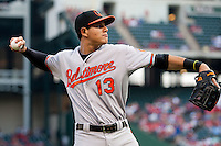 Baltimore Orioles third baseman Manny Machado #13 warms up prior to the Major League Baseball game against the Texas Rangers on August 21st, 2012 at the Rangers Ballpark in Arlington, Texas. The Orioles defeated the Rangers 5-3. (Andrew Woolley/Four Seam Images)..