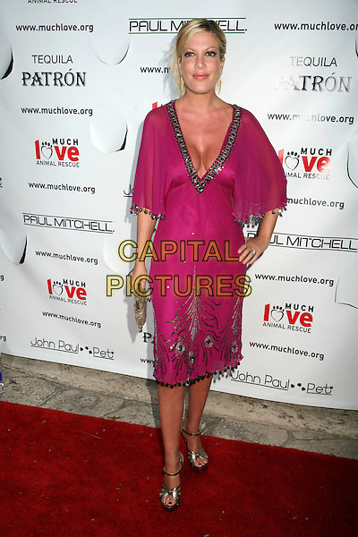 "TORI SPELLING .Bow Wow Ciao Benefit For ""Much Love"" Animal Rescue, Malibu, California, USA..August 5th, 2006.Photo: Byron Purvis/AdMedia/Capital Pictures.Ref: ADM/BP.full length purple pink fuschia dress cleavage hand on hip.www.capitalpictures.com.sales@capitalpictures.com.©Byron Purvis/AdMedia/Capital Pictures."
