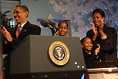 Washington, DC - December 3, 2009 -- The First family lights the National Christmas tree on the Ellipse in Washington, D.C. on Thursday, December 3, 2009.  From left to right: United States President Barack Obama, Malia Obama, Sasha Obama, and first lady Michelle Obama..Credit: Dennis Brack / Pool via CNP
