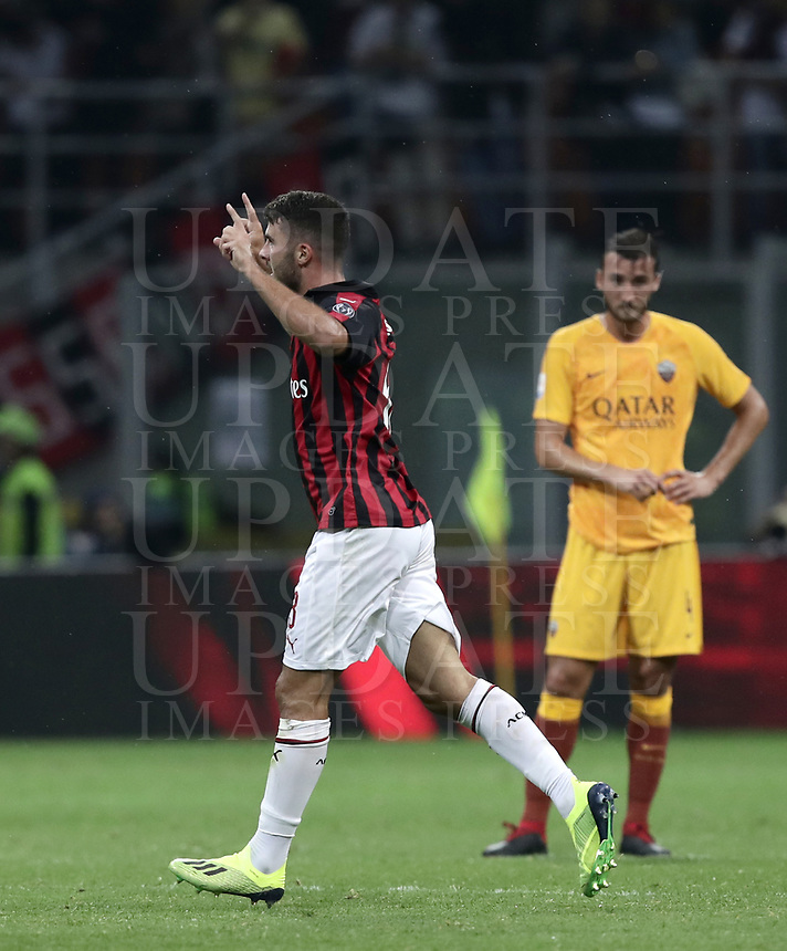 Calcio, Serie A: AC Milan - AS Roma, Milano stadio Giuseppe Meazza (San Siro) 31 agosto 2018. <br /> AC Milan's Patrick Cutrone (l) celebrates after scoring during the Italian Serie A football match between Milan and Roma at Giuseppe Meazza stadium, August 31, 2018. <br /> UPDATE IMAGES PRESS/Isabella Bonotto