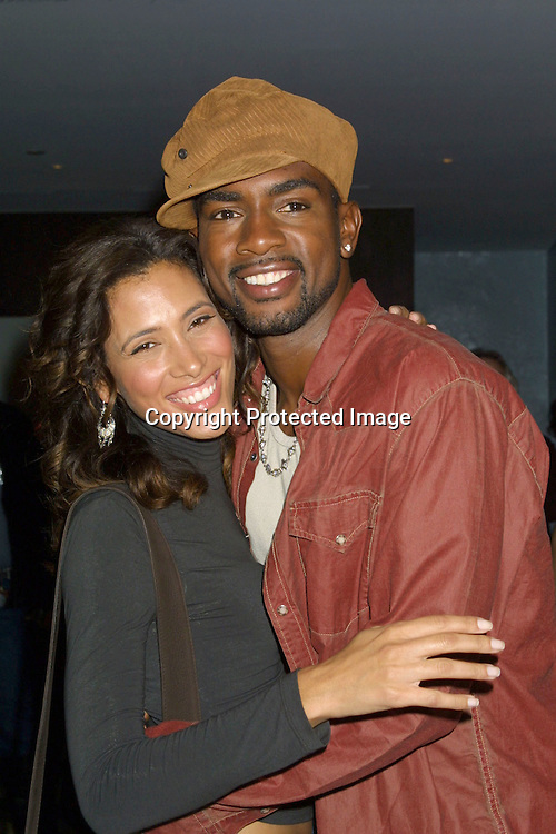 "©2002 KATHY HUTCHINS / HUTCHINS PHOTO .PREMIERE PARTY FOR FOX'S ""FASTLANE"" TV SHOW.AUGUST 5, 2002.THE STANDARD HOTEL.W. HOLLYWOOD, CA..BILL BELLAMY.WIFE, KRISTEN BAKER BELLAMY"