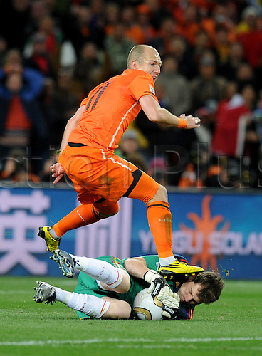 Arjen Robben of Netherlands fights for the ball with Iker Casillas of Spain during the 2010 FIFA World Cup Final soccer match between Netherlands and Spain at Soccer City Stadium on July 11, 2010 in Johannesburg, South Africa.