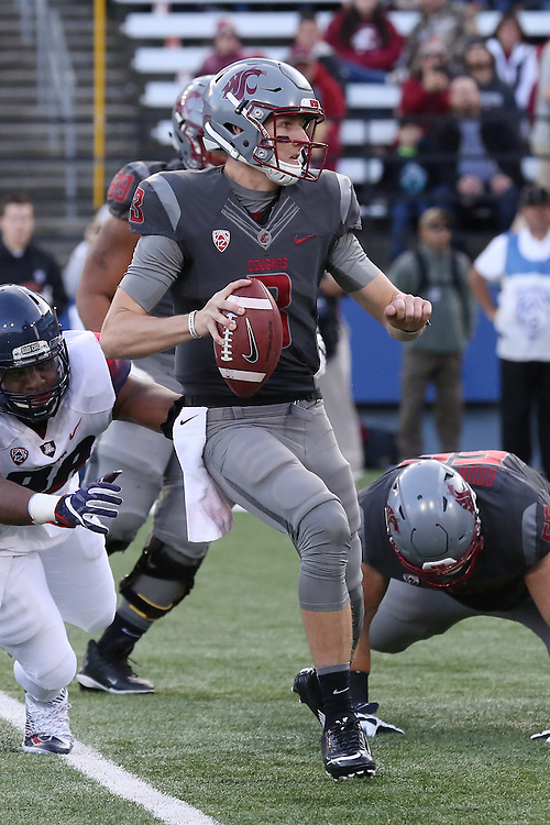 Tyler Hilinski, Washington State quarterback, looks for an open receiver down field during the Cougars Pac-12 Conference demolition of the Arizona Wildcats, 69-7, on November 5, 2016, at Martin Stadium in Pullman, Washington.