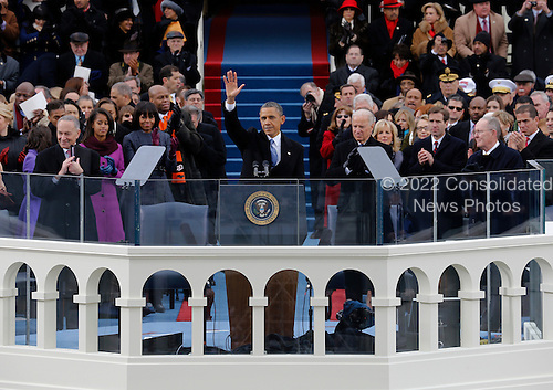 United States President Barack Obama waves to crowd after his speech at the ceremonial swearing-in at the U.S. Capitol during the 57th Presidential Inauguration in Washington, Monday, January 21, 2013. .Credit: Scott Andrews / Pool via CNP