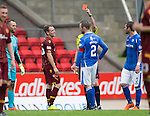 St Johnstone v Motherwell...22.08.15  SPFL   McDiarmid Park, Perth<br /> Referee Craig Thomson sends off Jake Taylor after showing him a second yellow card for diving<br /> Picture by Graeme Hart.<br /> Copyright Perthshire Picture Agency<br /> Tel: 01738 623350  Mobile: 07990 594431