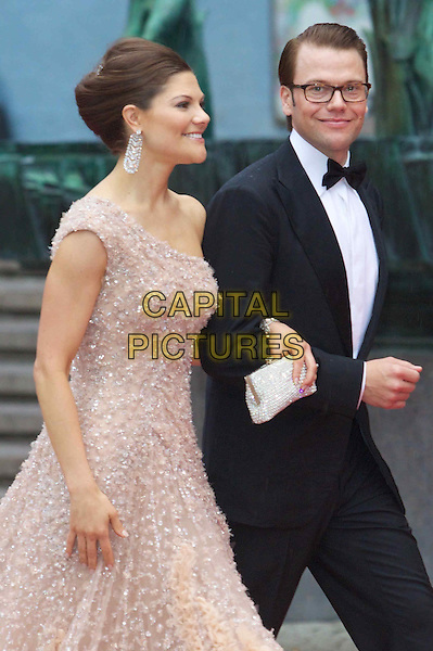 CROWN PRINCESS VICTORIA OF SWEDEN & DANIEL WESTLING .Gala Evening to celebrate the wedding of Swedish Crown Princess Victoria and Daniel Westling, Concert Halls, Stockholm, Sweden,.18th June 2010..royal half length one shoulder beige  dress  black tuxedo tux glasses side profile .CAP/PPG/WS.©Willi Schneider/People Picture/Capital Pictures