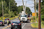 WOLCOTT CT. - 08 August 2020-080820SV07-Electrical crews working with Eversource hang power lines on Wolcott Road in Wolcott Saturday.<br /> Steven Valenti Republican-American