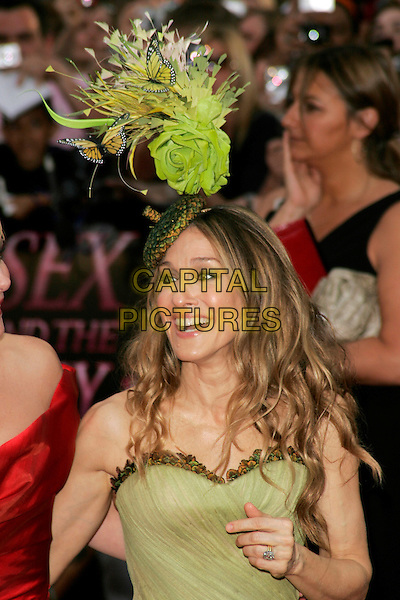 """SARAH JESSICA PARKER.Arrivals at the """"Sex And The City: The Movie"""" World Premiere, Odeon Leicester Square, London, England, UK. .May 12th 2008 .SATC half length green strapless McQueen dress feather butterfly hat Philip Treacy butterflies rose flower feathers ring.CAP/AH.©Adam Houghton/Capital Pictures."""