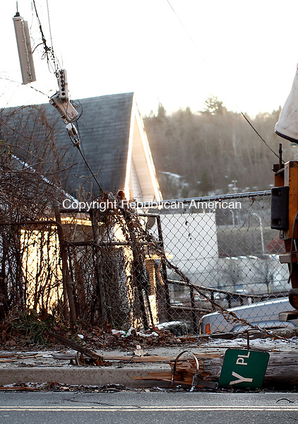 Waterbury, CT- 27 December 2013-122713CM02-  Pieces of a damaged utility pole lay on Wolcott Street after a car crash near the intersection of Wolcott and Howard Streets in Waterbury Friday afternoon .   Christopher Massa Republican-American