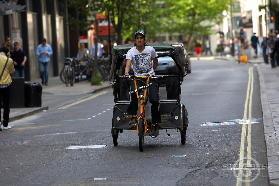 Bicycle Rickshaw..London , May 2009..pic copyright Steve Behr / Stockfile