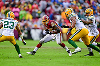 Landover, MD - September 23, 2018: Washington Redskins running back Adrian Peterson (26) runs the football during game between the Green Bay Packers and the Washington Redskins at FedEx Field in Landover, MD. The Redskins get the win 31-17 over the visiting Packers. (Photo by Phillip Peters/Media Images International)
