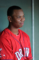 Third baseman Rafael Devers (13) of the Greenville Drive is pictured in the dugout before a game against the Augusta GreenJackets on Thursday, June 11, 2015, at Fluor Field at the West End in Greenville, South Carolina. Devers is the No. 6 prospect of the Boston Red Sox, according to Baseball America. Greenville won, 10-1. (Tom Priddy/Four Seam Images)