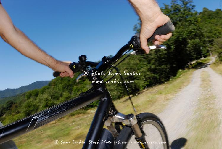 Man speeding on mountain bike
