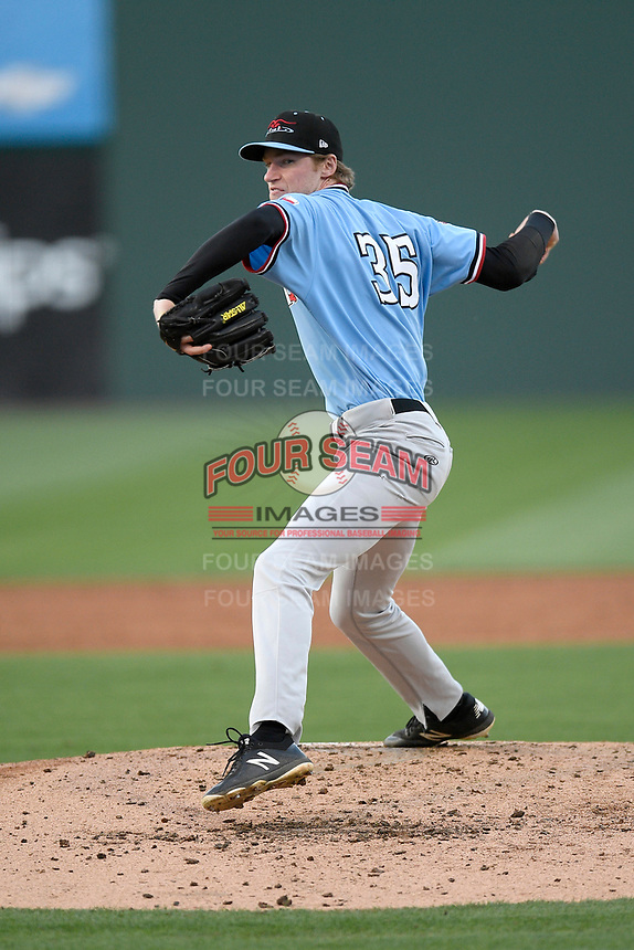 Pitcher Sean Chandler (35) of the Hickory Crawdads delivers a pitch in a game against the Greenville Drive on Wednesday, May 15, 2019, at Fluor Field at the West End in Greenville, South Carolina. Greenville won, 6-5. (Tom Priddy/Four Seam Images)