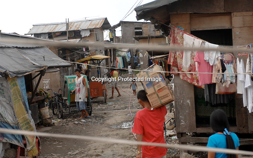 "The Basico port area slum of Manila, the ""kindey market where over 300 men have sold their kidneys.  All recieved between 70,000 -  90,000 pesos (800 - 1030 pounds).  More than 300 have sold their kidneys in this slum of 16,000 people.<br /> <br /> PHORO BY RICHARD"