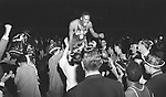 19 MAR 1955: University of San Francisco's Bill Russell (6) gets a ride off the court by fans after defeating La Salle 77-63 to win the NCAA National Basketball title in Kansas City, MO, Municipal Auditorium. Russell was named most outstanding player with 47 points scored. Rich Clarkson/NCAA Photos.