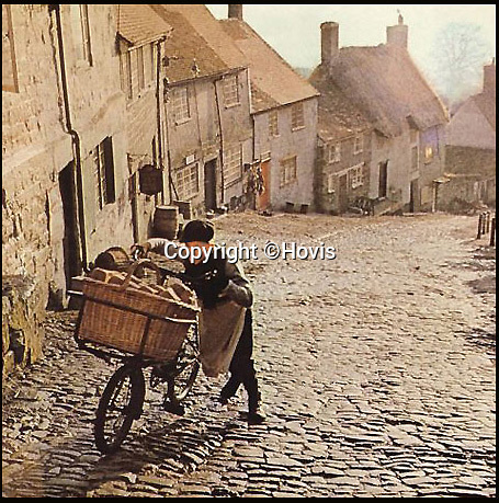BNPS.co.uk (01202 558833)<br /> Pic: Hovis/BNPS<br /> <br /> The child actor who starred in the famous Hovis bread TV advert has finally conquered the cobbled hill 44 years later - by using an electric bike to ride up it.Carl Barlow, now aged 58, appeared in the iconic 1973 commercial at the age of 13 where he was seen struggling to push a bike up the steep hill to deliver bread.The advert, which depicts a northern industrial town but was actually shot on Gold Hill in Shaftebury, Dorset, has been voted as the nation's favourite TV commercial of all time.Carl, a retired firefighter, has now returned to 'Hovis Hill' to peddle up it non-stop using an electric bike.