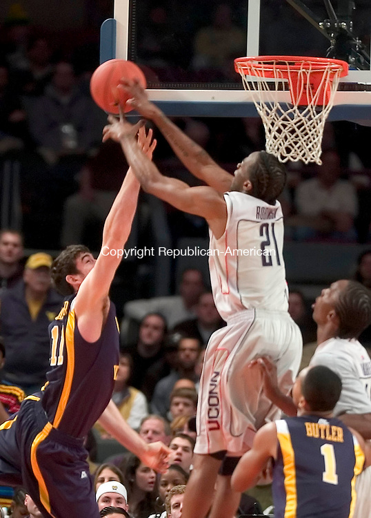 NEW YORK, NY --13 MARCH 2008-031308JS16-UConn's Stanley Robinson blocks a shot by West Virginia's Joe Alexander during their Big East Tournament game Thursday at Madison Square Garden in New York City. <br /> Jim Shannon/Republican-American