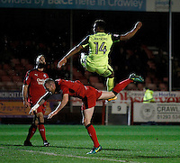 Exeter City's Ollie Watkins challenges Crawley Town's Mark Connolly for the cross during the Sky Bet League 2 match between Crawley Town and Exeter City at Broadfield Stadium, Crawley, England on 28 February 2017. Photo by Carlton Myrie / PRiME Media Images.
