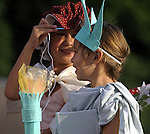 Jacki Federican, 6, of Ellington, dressed as Betsy Ross, sticks her needle towards the crown on the head of her sister Kacey, 6, who is dressed like the Statue of Liberty, at the start of the kids parade during the annual July in the Sky celebration, Wednesday, July 3, 2013, in down Rockville.  (Jim Michaud / Journal Inquirer)