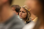 A student listens to a presentation about Rwanda during an annual conference for Breakaway in College Station, TX.