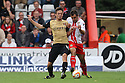 Peter Hartley of Stevenage battles with David Mooney of Leyton Orient<br />  - Stevenage v Leyton Orient - Sky Bet League 1 - Lamex Stadium, Stevenage - 17th August, 2013<br />  © Kevin Coleman 2013