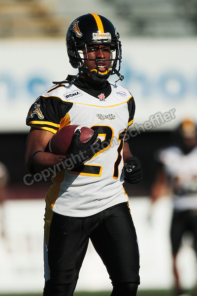 Jun 22, 2007; Hamilton, ON, CAN; Hamilton Tiger-Cats defensive back (21) Sir James Delgardo during the game against the Winnipeg Blue Bombers in CFL preseason action at Ivor Wynne Stadium. The Tiger-Cats defeated the Blue Bombers 24-20. Mandatory Credit: Ron Scheffler, Special to the Spectator. For exclusive EDITORIAL use by the Hamilton Spectator only.