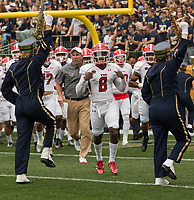 Youngstown State head football coach Bo Pellini and his team run through the Pitt marching band as they enter the field. The Pitt Panthers defeated the Youngstown State Penguins 28-21 in overtime at Heinz Field, Pittsburgh, Pennsylvania on September 02, 2017.