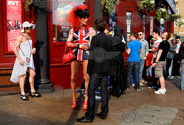 A man wears a Geri Haliwell Union Jack minidress outside a bar in south London during for a gay marriage fundraiser organized by Outrage! on the day of the Royal Wedding between Britain's Prince William and Kate Middleton.