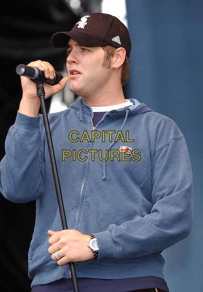 WESTLIFE - Brian MCFADDEN<br /> 96.4 BRBM's Party in the Park <br /> sales@capitalpictures.com<br /> www.capitalpictures.com<br /> &copy;Capital Pictures<br /> music, live, concert, stage, singing, hooded top, baseball cap