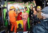 People dance at the Mountain Dew Bust-A-Move Video Booth during Freakfest 2015 on State Street in Madison, Wisconsin