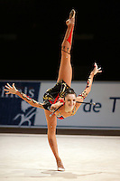 Anna Bessonova of Ukraine holds scale with clubs during All-Around at 2006 Thiais Grand Prix in Paris, France on March 25, 2006.  (Photo by Tom Theobald)