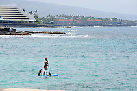 "Woman and dog on a Hawaiian ""stand up paddle"" board, Kailua Bay, Kailua-Kona, Big Island, Hawaii"