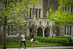 Students walk to and from class past the Allen Building through the Academic Quad on a beautiful Spring morning.