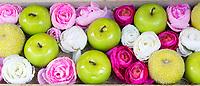 Shop window display of flowers and apples in Bruges, Belgium