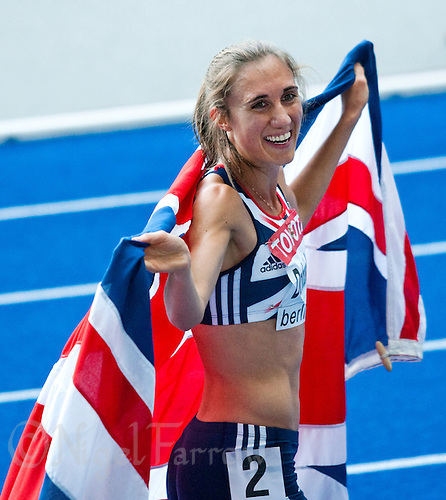 23 AUG 2009 - BERLIN, GER - Lisa Dobriskey (GBR) celebrates her silver medal in the Womens 1500m Final after initial winner Natalia Rodriguez (ESP) is disqualified at the World Athletics Championships (PHOTO (C) NIGEL FARROW)