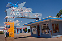 The Blue Swallow Motel on Route 66 in Tucumcari, New Mexico,  was built in 1939 by W. A. Huggins. It features a unique, personal shell design on the exterior stucco. Garages, a signature of motor courts of the era, are another unique characteristic of this motel. According to Huggins' son, Phares, it was sold at a loss because of economic conditions at the onset of WWII. With gas and tire rationing in effect, people weren't traveling as much. <br /> The best known proprietor of the Blue Swallow was Lillian Redman, who acquired it in 1958. She operated the motel for almost 40 years, facing numerous difficulties including the interstate bypass, which drastically reduced her customer base. There is much information available about Lillian online and in numerous publications. <br /> Your hosts, Terri &amp; Bill, have purchased the Blue Swallow Motel, and welcome you to this Route 66 landmark. They are keeping the tradition of hospitality alive.