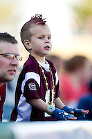A young Missouri State Bears fan cheers on the team during a game between the Missouri State Bears and Southern Illinois University- Edwardsville Cougars at Hammons Field on March 9, 2012 in Springfield, Missouri. (David Welker / Four Seam Images)