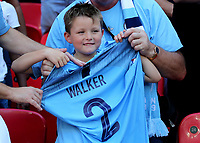 A young Manchester City fan proudly holds up Kyle Walker's shirt after the England player handed his shirt over after the celebrations during Chelsea vs Manchester City, FA Community Shield Football at Wembley Stadium on 5th August 2018