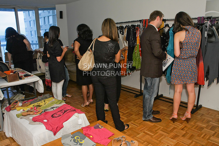 Guests look at clothing during the Misha Nicole/Sakhi empower a friend, and shopping event on July 14, 2010.