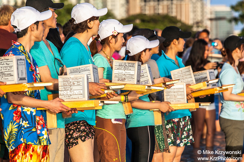 Japanese participants holding lanterns at the 15th annual Lantern Floating Ceremony at Ala Moana Beach Park in Honolulu on Memorial Day