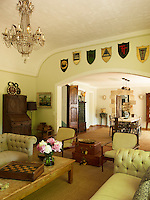 A collection of old regional shields is displayed on the wall between the dining and living areas