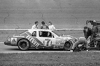 HAMPTON, GA - NOV 3: Rescue workers attend to Kyle Petty and his #7 Ford after a crash in the Atlanta Journal 500 NASCAR Winston Cup race at Atlanta Motor Speedway, November 3, 1985. (Photo by Brian Cleary/www.bcpix.com)