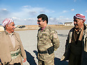Iraq 2014                  <br /> Sirwan Barzani, Peshmerga officer in charge of the 6th branch , Mahmur district, with old peshmergas <br /> Irak 2014 <br /> Sirwan Barzani, officier de peshmergas, responsable de la 6eme branche du front de Mahmur avec de vieux peshmergas