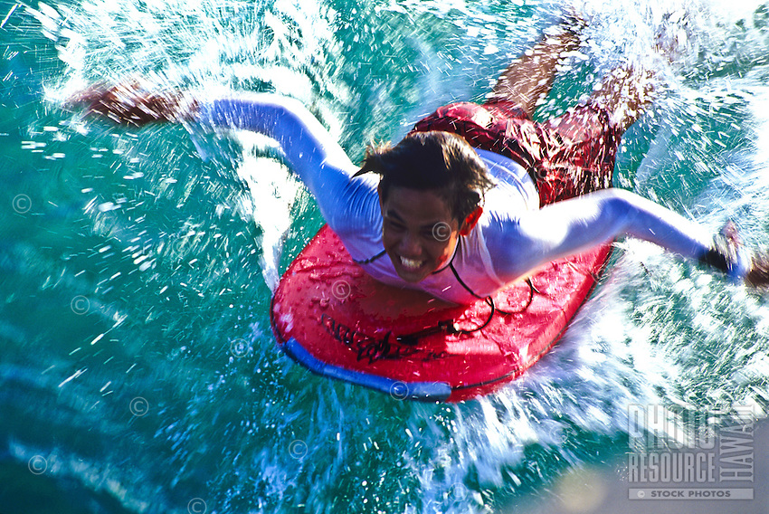 """Young boogie boarder at the """"""""Wall"""""""" at the Kapahulu groin, Waikiki"""