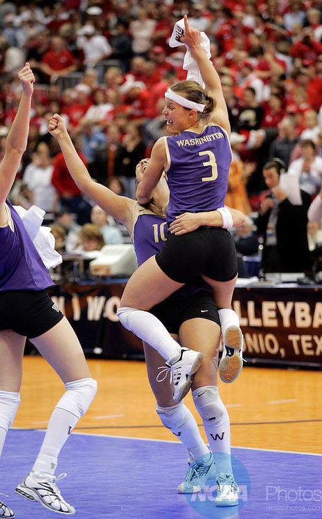 17 DEC 2005:  Courtney Thompson (3) and Brie Hagerty (10) of the University of Washington celebrate their victory over the University of Nebraska during the Division I Women's Volleyball Championship held at the Alamodome in San Antonio, TX.   Washington defeated Nebraska 3-0 to win the national title.  Jamie Schwaberow/NCAA Photos