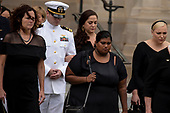 Members of the McCain family follow as a Military Honor Guard carries the casket of late Senator John McCain, Republican of Arizona, after a funeral service at the Washington National Cathedral in Washington, DC on September 1, 2018. <br /> Credit: Alex Edelman / CNP
